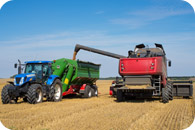 Combine harvesting corn | Farm Insurance